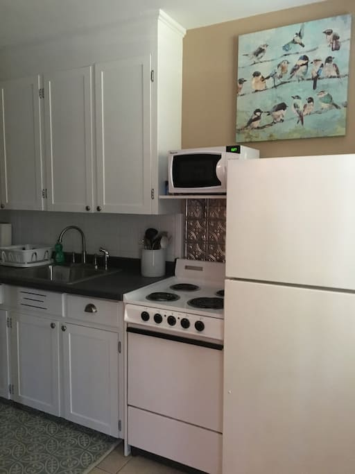 Kitchen with stove, microwave, refrigerator, coffee maker and all essentials to cook a full meal