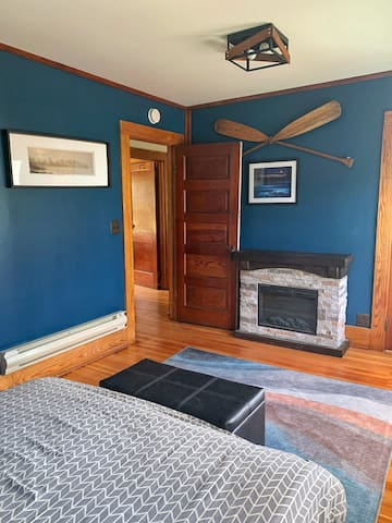 The Lake Room offers a queen bed and electric fireplace.