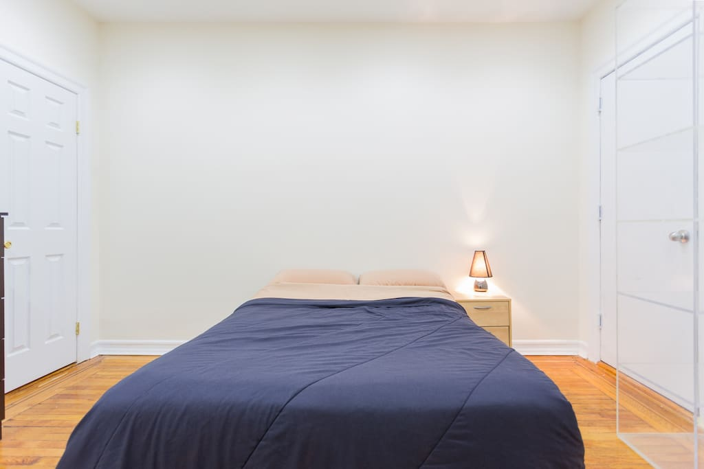 Bedroom features a full size bed, dresser, lamp, 2 chairs, large closet and night stand.