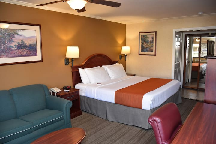 Deluxe Room with a King Bed. All rooms are independent from each other with exterior corridor. Only accepting reservations  for essential travelers or if you have no place to stay.