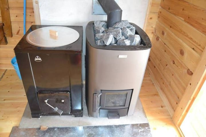 Sauna stove and firewood used water heater