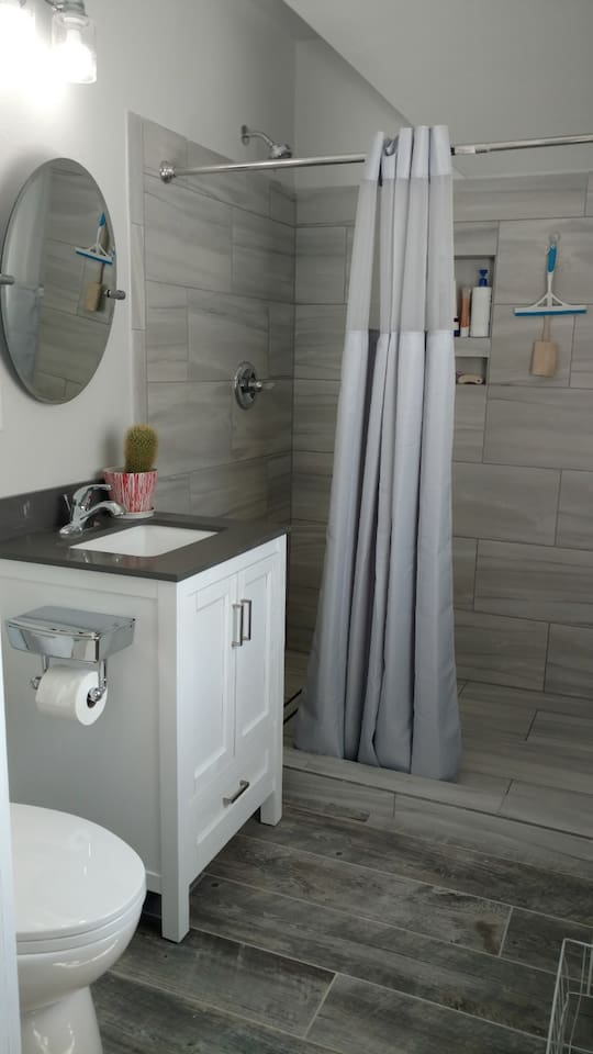 This Private Bath is just for the apartment listed. Definitely a two person shower and very modern with high quality soaps, shampoos, conditions and lotions