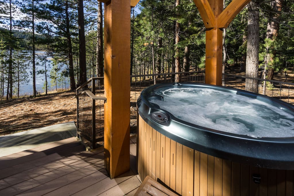 Private hot tub on deck with forest and lake views