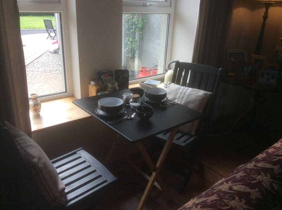A table for 2 by the window , some cereal, yogurt and coffee/tea before leaving to explore!