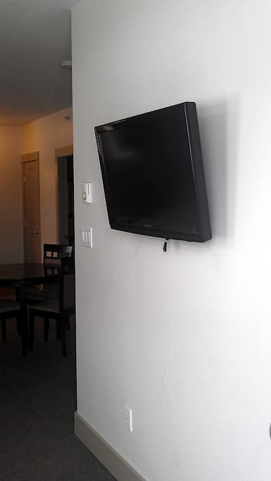 Flat Screen TV   in every Suite 32 inches / 81 cm Pemberton Gateway Village Suites Hotel.