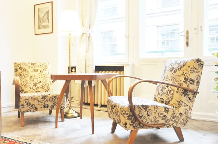 Nice bedroom with great Halabala design chairs and view to Štěpánská street and Wenceslas Square. Enjoy historical apartment of great Lucerna palace. Bedroom with king size bed, huge living room and fully equipped kitchen will do your trip pleasant.