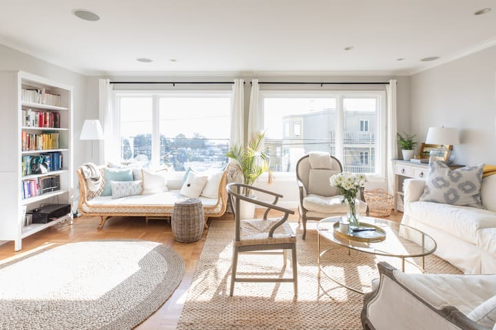 Sunny living room with views of the city and San Francisco Bay.