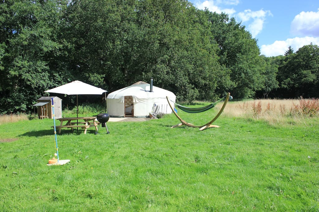 Oak Tree Yurt with a private outdoor space including a family sized hammock, picnic table, bbq and swing tennis