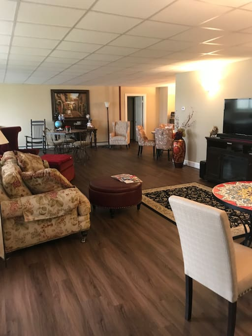 Attached luxury family room with theatre 55 inch TV with sound bar;  11 large windows with plantation blinds viewing a 2-acre pond!