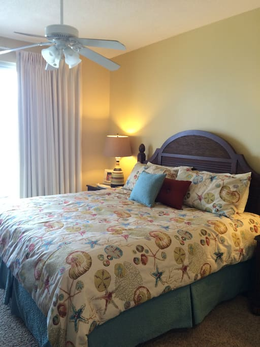Ocean view master bedroom with king bed and adjoining bath
