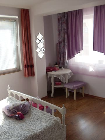 lavender room with french bed - good for a couple or solo travelers. Spacious room with sea view from its private terrace The bathroom comes with toiletries and shower.