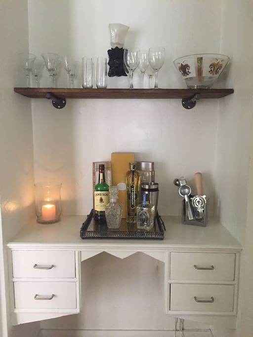 Hallway features a built in bar and charming vintage detailing.