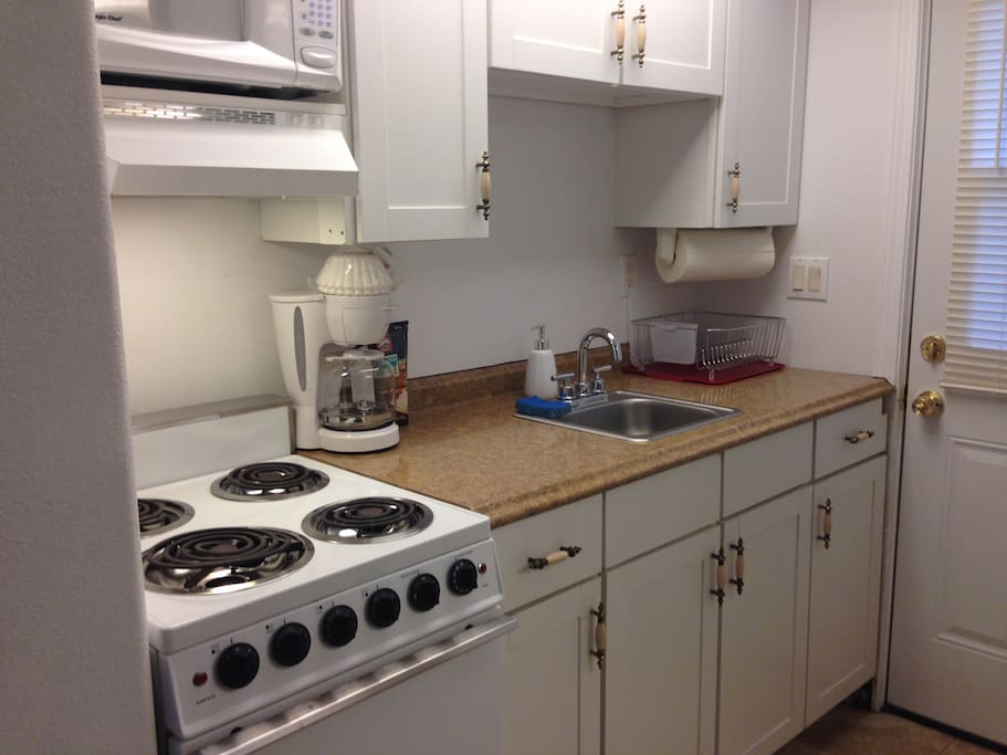 Save money by eating at home.  Complete kitchen facilities including Stove w Oven, Refrigerator, Microwave, Coffee Maker, plates, dishes, silverware, etc.