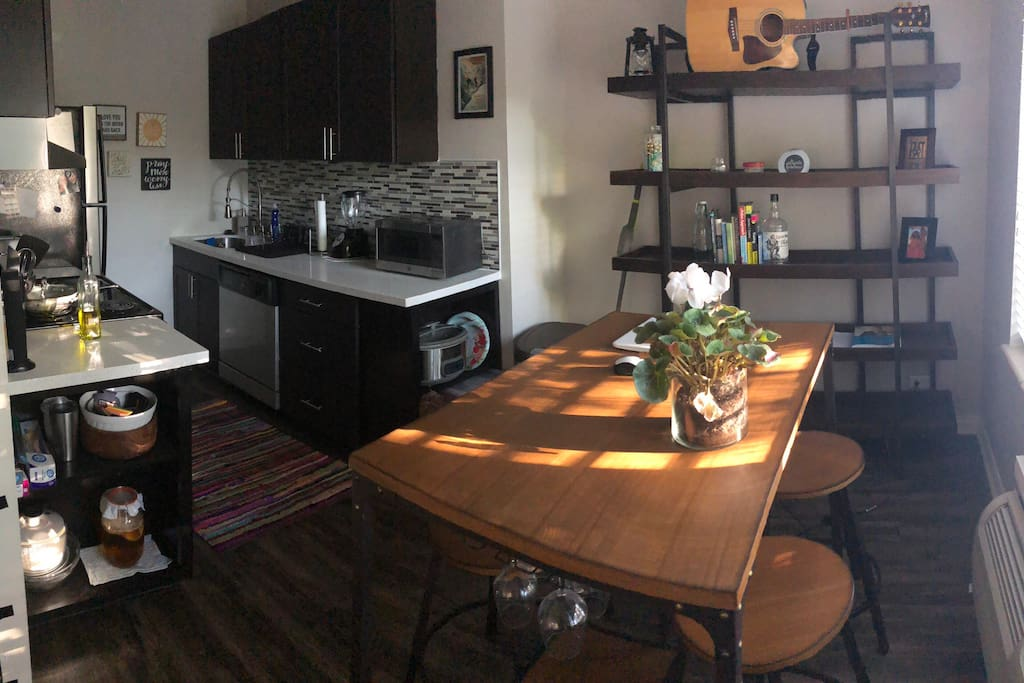 This is the kitchen which is right off the main living area. It has stove top, oven, refrigerator, microwave. The built in on the right underneath the microwave will be cleared for you to store pantry items in.