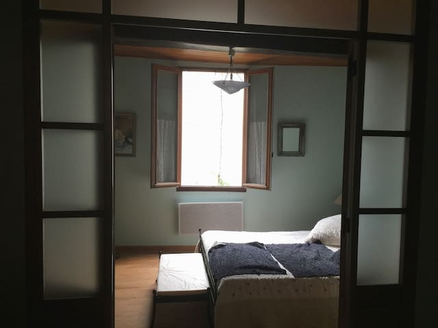 Second bedroom with french doors to third bedroom.