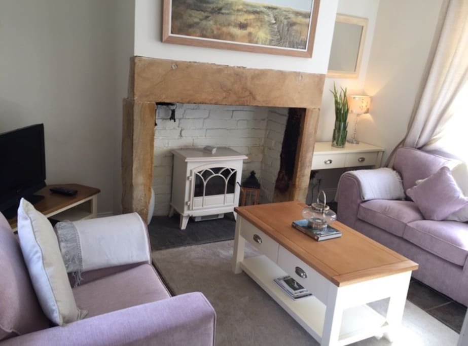 Cosy country style lounge with TV, DVD player, electric stove, windows facing the rear yard garden and front courtyard garden. A perfect place to sit back and relax after a busy day exploring.