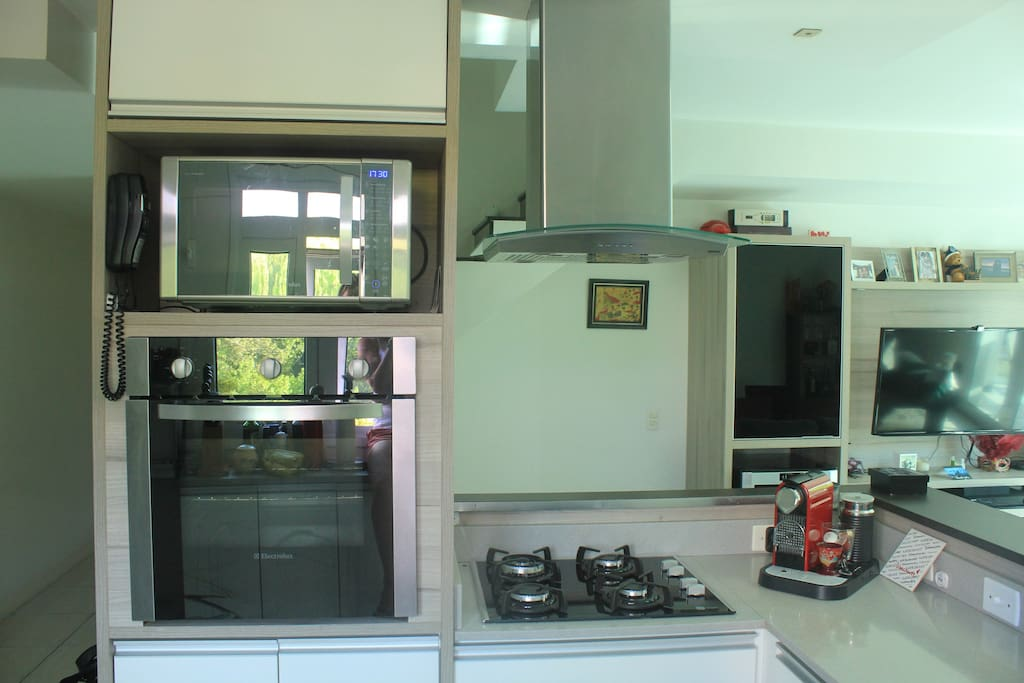 Kitchen equipped with stove top, oven and microwave
