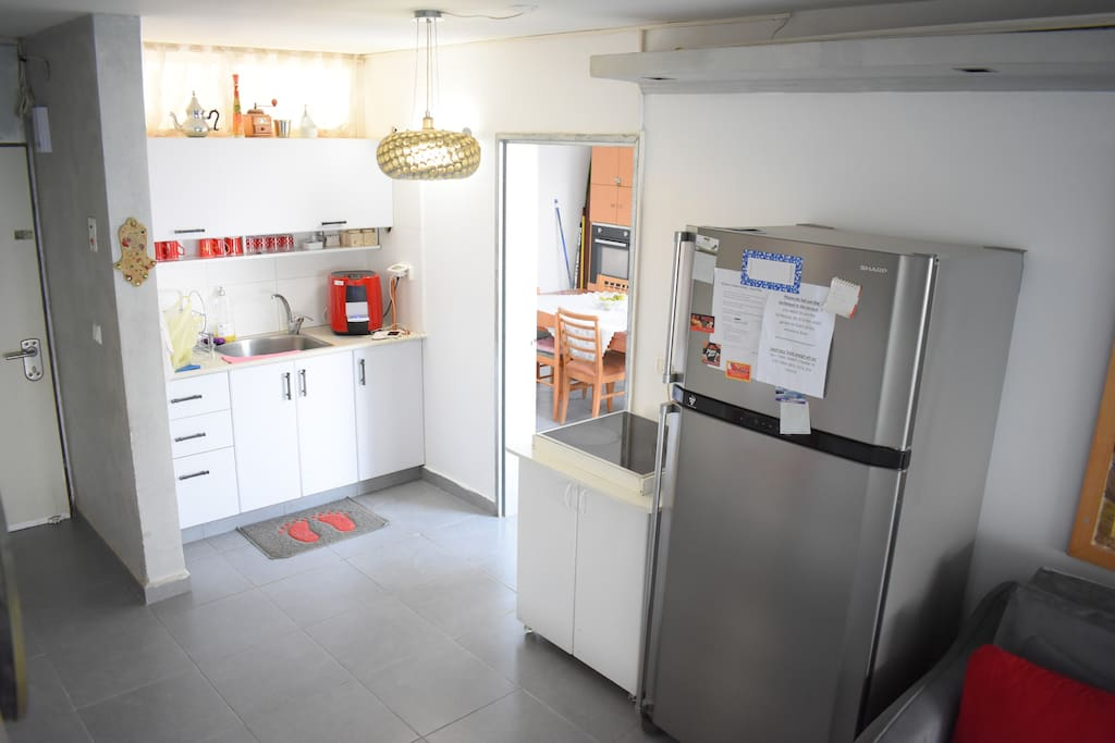 The fully equipped kitchen + a door to one of the bedrooms (1st floor)