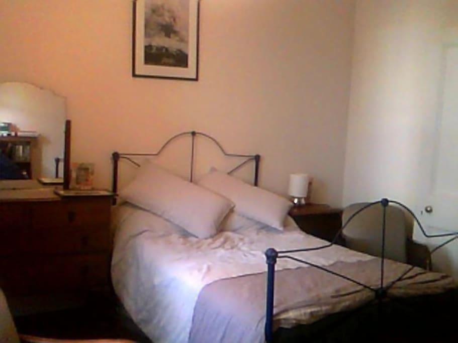 Great Grandma's iron bed, (but a new mattress)