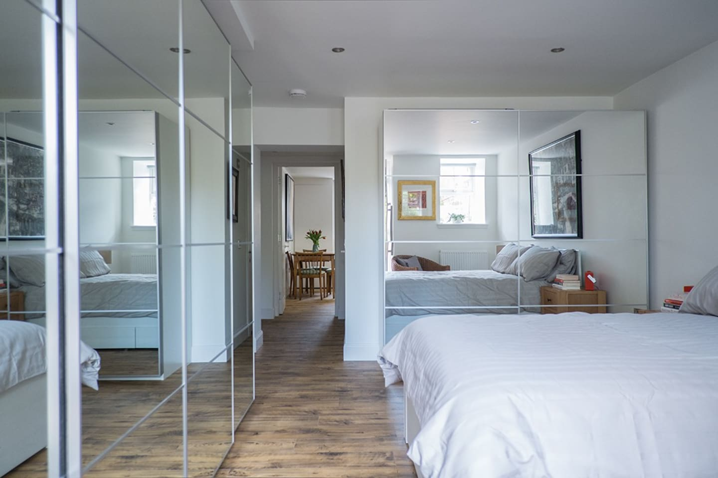 Airy double bedroom with lots of storage, looking through to living area