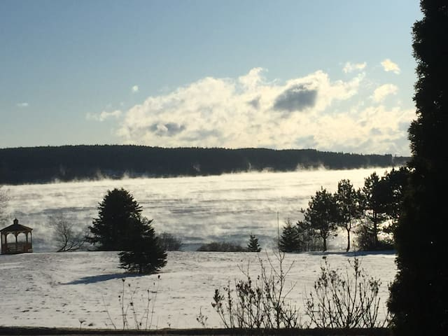"""Winter view of """"sea smoke"""" over Blue Hill bay from the Hen House."""