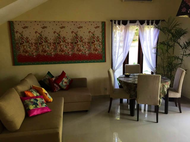 Sofa bed for 2 people and extending table with 6 chairs. Indonesian beautiful batik decorating your living room
