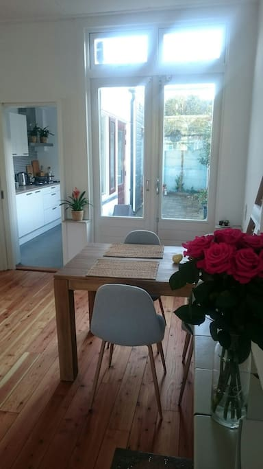 4 person dining table, double doors to all day sunny terrace, and brand new kitchen with everything you need (oven, microwave, gas stove, dishwasher, refrigerator, blender, pans, cutlery, plates, etc.)