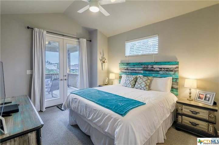 Master Bedroom with King Bed and private balcony access
