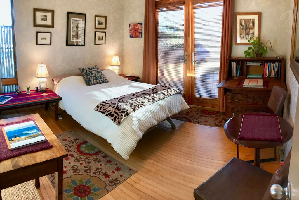 Comfy bed with memory foam mattress topper and great quality linens and pillows, antique Balinese furniture, hardwood floors and great light.
