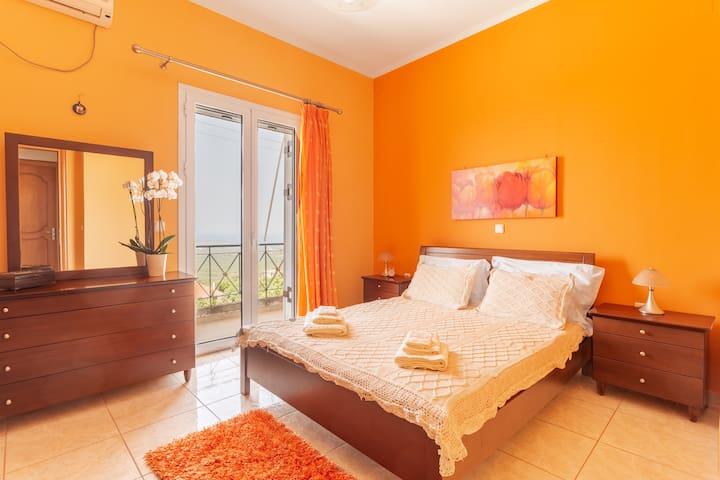Orange-themed ocean view room