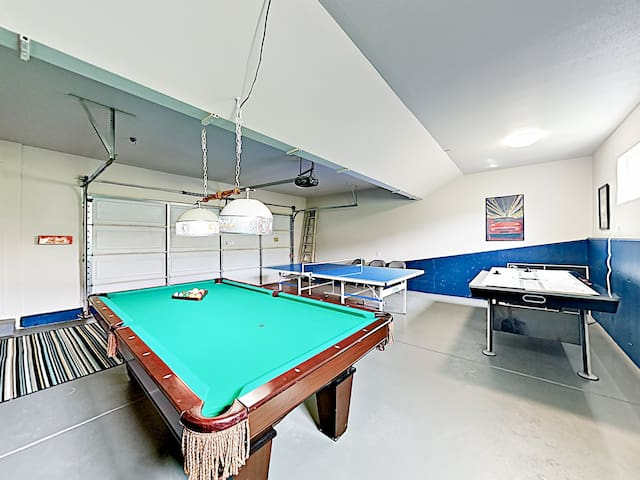 Downstairs, the converted garage has a pool table, air hockey, and ping-pong.