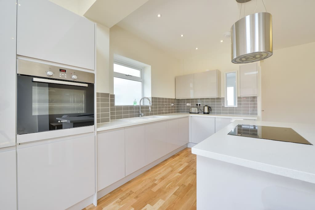 Fully equipped kitchen with integrated appliances