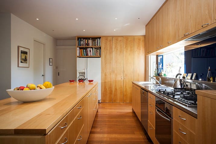 Kitchen - Natural wood island bench with modern appliances