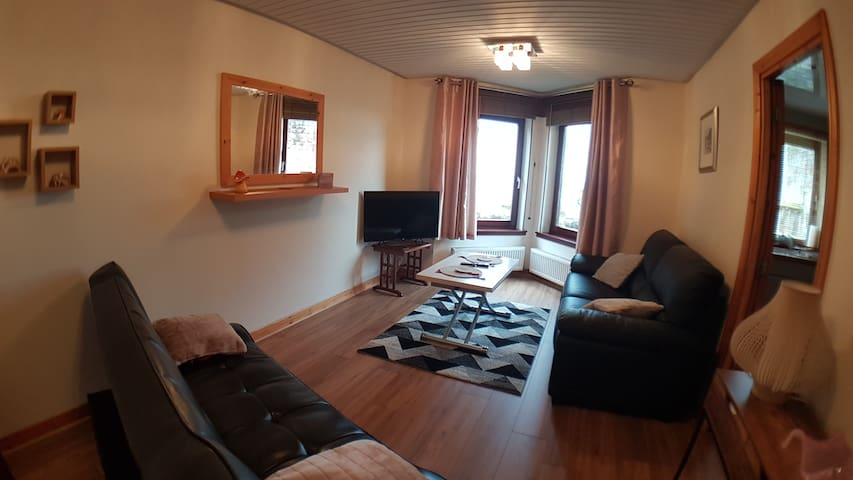 Comfortable lounge with sofa bed and lovely views of castle and across the water