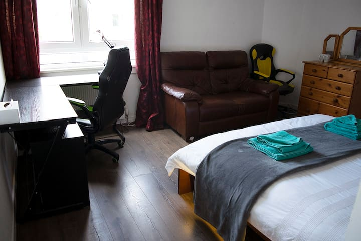 Double room 1 with large desk and wardrobes