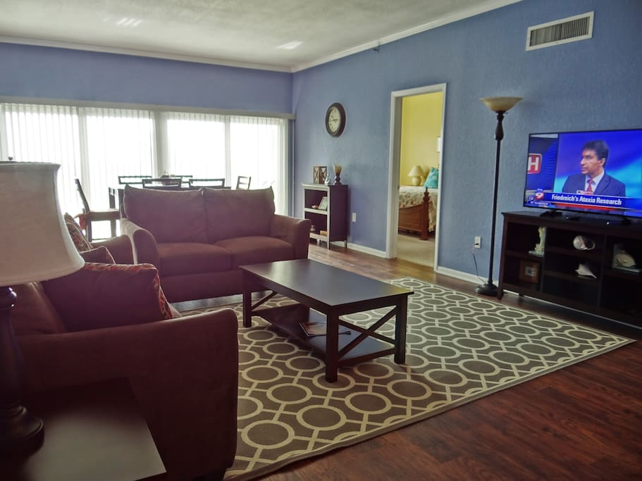 Newly Furnished Living Room with large screen HD TV with Roku