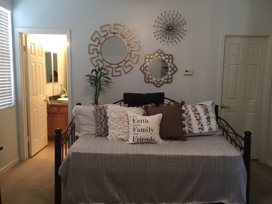 Main area is a day bed that transform into a twin bed, two twin beds or king sized sleeping arrangement. Let us know and we are happy to make appropriate beds! To the right is a walk in closet with spa robes for your use.