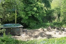 The hot tub is an additional extra (charged at £90), a 10 minute walk through the woods, by the stream