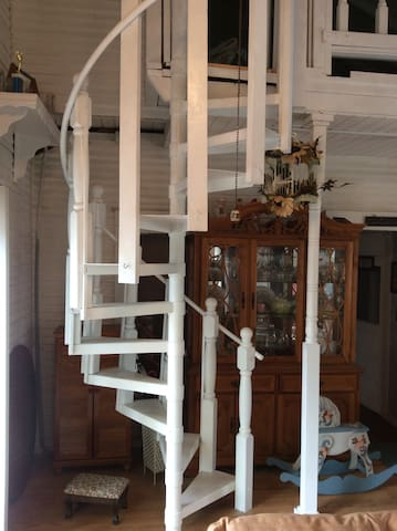 Metal spiral staircase leading to the upstairs bedroom loft. You must be able to bring your own luggage up these stairs.