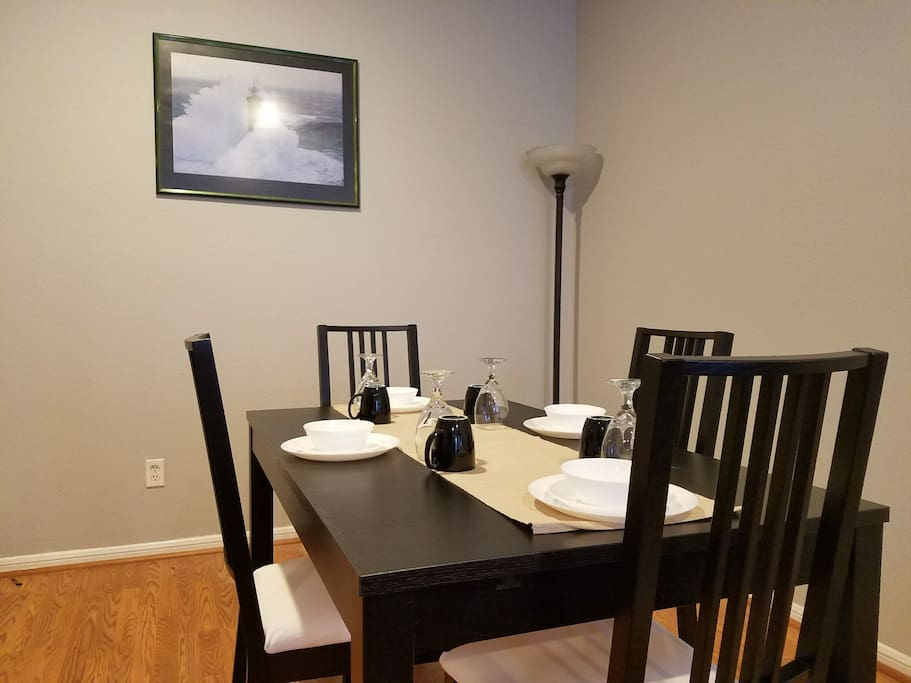 Dining table is set for 4, expandable to 8.