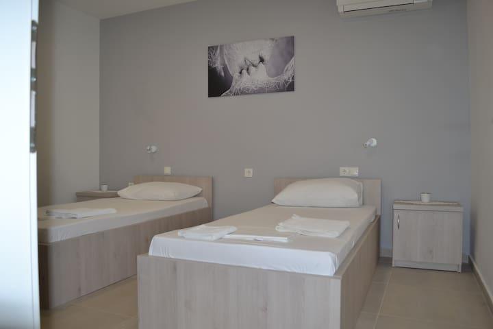 Private room and bathroom w/AC, center of Novalja