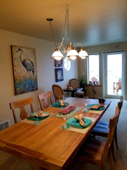 Dining area leads out to balcony.