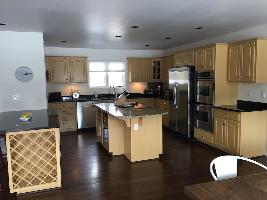 Gourmet kitchen features double oven, large fridge, lots of counter space, premium cookware. Stocked with all the pantry basics (spices, oil, flour, etc.).