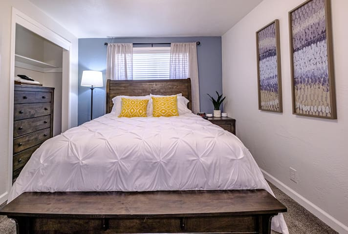 """Bedroom 1 Features: 43"""" Smart Roku TV with Netlfix and YouTube TV, Area Fan, Chest of drawers, alarm clock, white noise machine"""