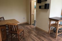 Dining area showing the door to the bathroom.