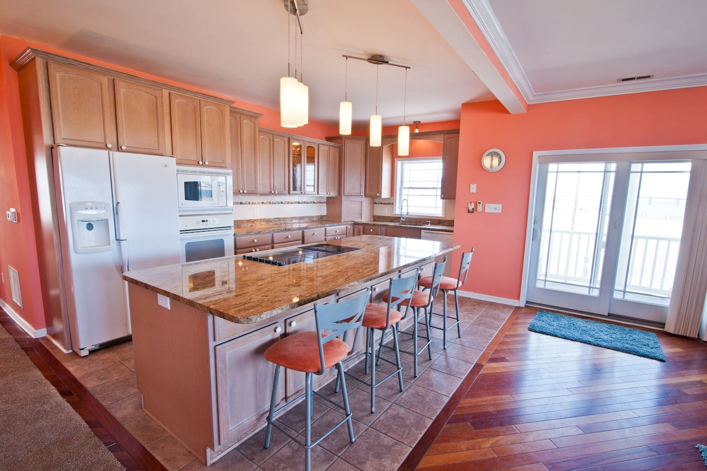 ❤️ Experience for yourself our Gourmet Kitchen with granite countertops and beautiful lighting! Take advantage of the HUGE kitchen island for your tasty treats and drinks! The kitchen is Stocked with Everything you could need!