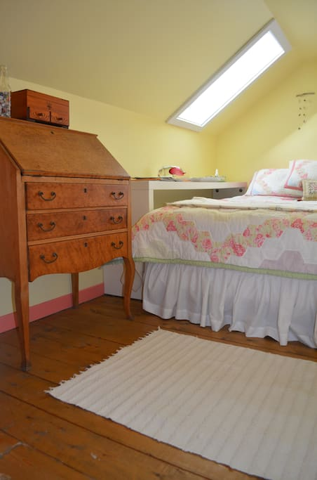 Yellow Bed Room (queen) with skylight and window.