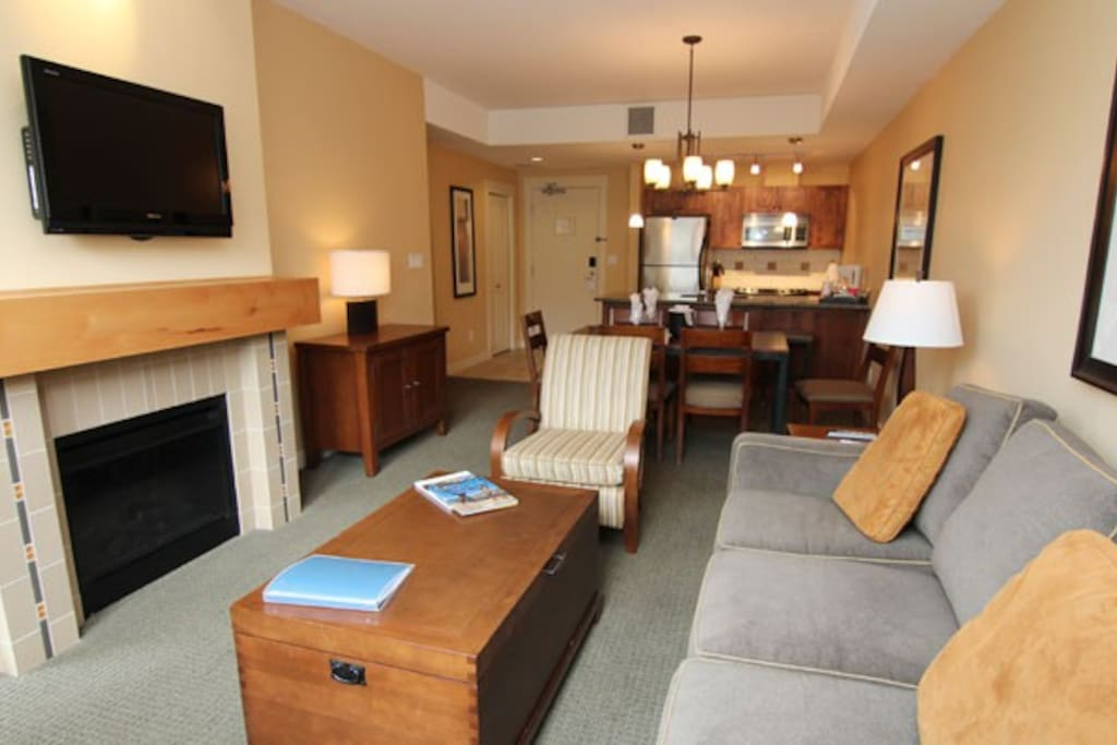 Relax in the cozy living area with a fireplace and flat screen TV.