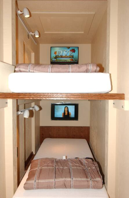 Separate European Lofts.  Two each single gel mattress beds each with Smart TV, Cable TV, Netflix, dimmable track lighting, and electrical outlets.