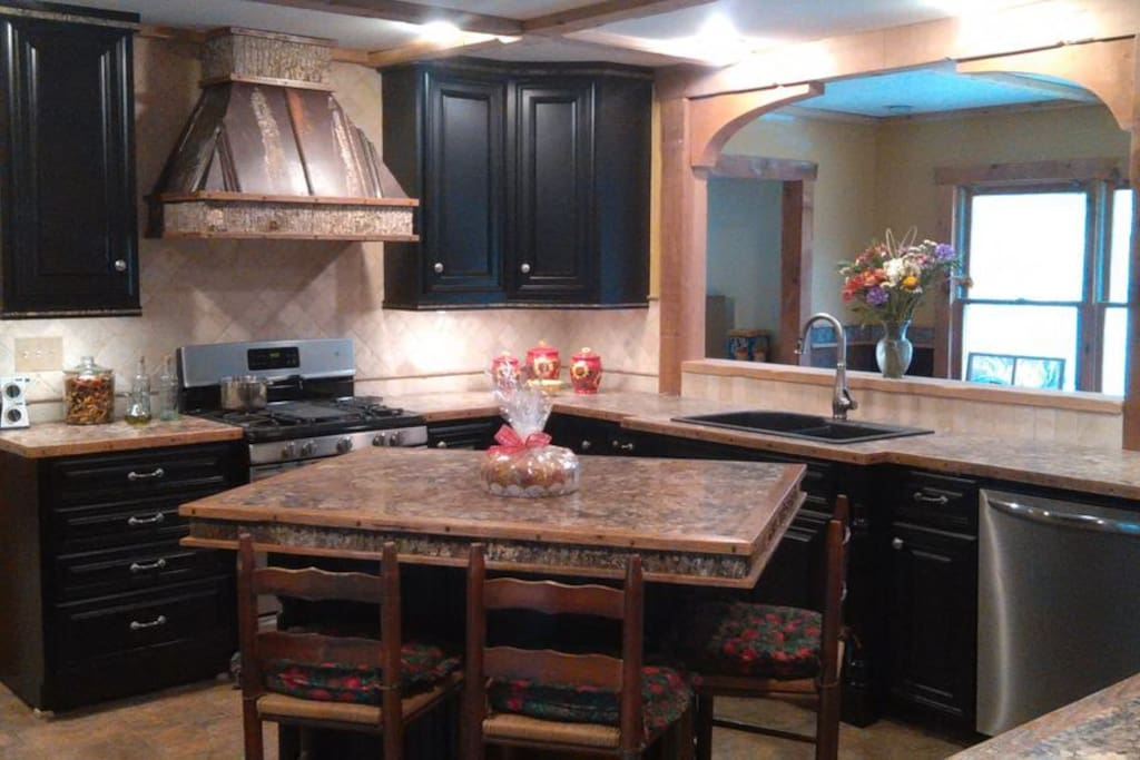Custom made kitchen cabinetry with Rustic trim.